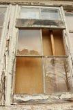 Boarded up derelict broken window panes Stock Photography