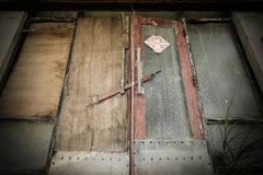 Closed and barricaded doors on an abandoned sanatorium. Boarded up doors at a long-abandoned sanatorium from the 1930s in Taiwan leftover from the days of Stock Photos