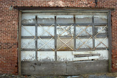 Boarded up garage door Royalty Free Stock Photography