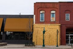 Boarded up building in Rochester, Michigan stock images