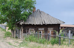 Boarded-up house. An old, abandoned wooden house Stock Image