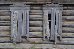 Boarded-up house. Boarded-up windows in abandoned house Stock Image