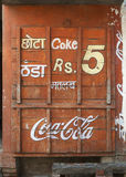 Boarded up little shop with Coca-Cola advertisement. Royalty Free Stock Image