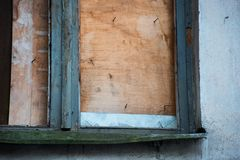 Boarded up old window. Is close stock image