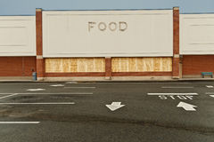 Boarded Up Out Of Business Grocery Store At Dusk Royalty Free Stock Images