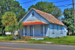 Boarded-Up Residential Home. An HDR image of a boared-up residential home with on a street in Ybor city florida Stock Images