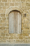 Boarded up window of antique building Royalty Free Stock Photography