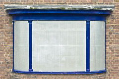 Boarded up window. A boarded up window on a building closed down royalty free stock photos