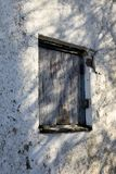 Boarded up window. Dilapidated rotten boarded up window on derelict building awaiting demolition stock photography