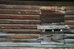 Boarded-up window on an Old Abandoned Wood House. On the Baikal island of Olhon fish factory royalty free stock photo