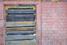 Boarded up window on an old brick wall. In the daytime royalty free stock photo