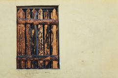 Boarded up window in an old building Stock Image