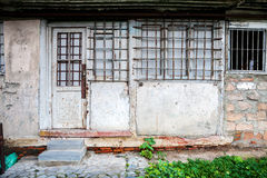 Boarded up window and old door Stock Photography