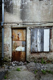 Boarded up window and rusty door Royalty Free Stock Photos