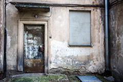 Boarded up window and rusty door Stock Photography