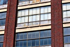 Boarded Up Windows. With a red brick background stock photography