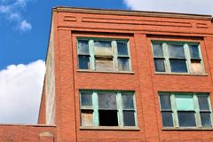 Boarded Up Windows. With a red brick background royalty free stock images