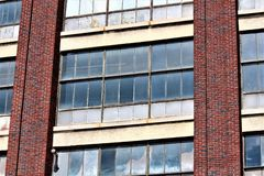 Boarded Up Windows. With a red brick background stock image