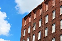 Boarded Up Windows. With a red brick background royalty free stock photo