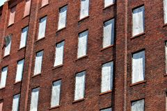 Boarded Up Windows. With a red brick background stock images