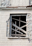 Boarded window of old house Stock Image