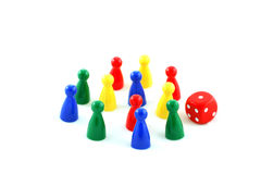 Boardgame pieces. And a die royalty free stock images