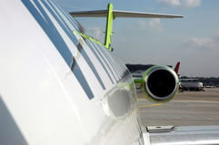 Before the boarding. View to the rear side of the fuselage of the Fokker-100 plane royalty free stock photos