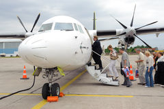 Boarding on Air Baltic propeller airplane Stock Photography