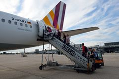 Boarding. Airplane at the stuttgart airport. Tourists are boarding the plane Royalty Free Stock Images