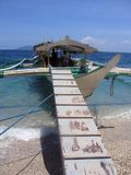 Boarding Banka Outrigger sabang beach  Philippines Royalty Free Stock Image