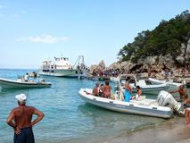 Boarding boats at Cala Luna Beach Stock Image