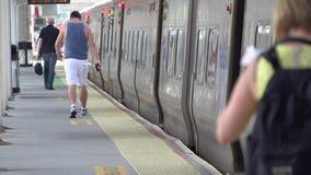 Boarding a commuter train (1 of 6) stock video