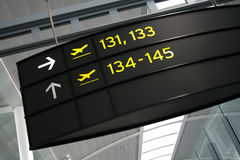 Boarding Gates. The boarding gates for departures sign at the airport Stock Photo