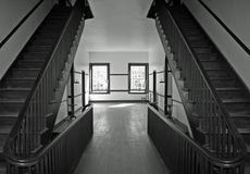 The Boarding House. Interior hallway of a 19th century boarding house in black and white Stock Image