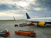 Boarding the Luggage. In a passenger aircraft Stock Image