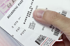 Boarding pass. Hand giving the boarding pass to the immigration Royalty Free Stock Image
