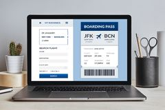 Boarding pass concept on laptop screen on modern desk. All screen content is designed by me. Front view stock photo