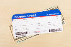 Boarding pass and dollar banknote. Concept for travel expenses Stock Photos