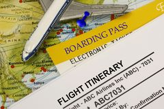 Boarding pass and flight itinerary. Flight Itinerary with boarding pass and airplane model toy - concept for travel Royalty Free Stock Image
