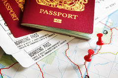 Boarding pass and passport. On map with thumbtack concept for travel and vacations Stock Image