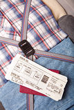 Boarding pass passport on suitcase. Boarding pass and passport on packed suitcase Stock Photo