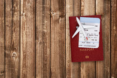 Boarding pass, passport and toy aircraft. On wooden table Stock Photography