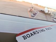 Boarding pass ticket at the airport terminal. In the late afternoon with the plane at the terminal gate stock photography