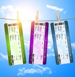 Boarding pass tickets  hanging on clothesline over blue sky Royalty Free Stock Images