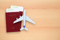 Boarding passes, passports and toy aircraft Stock Images