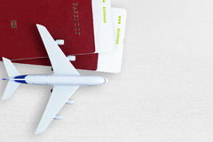 Boarding passes, passports and toy plane. On table Royalty Free Stock Images