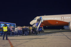 Boarding a plane at night. Apron stock photography