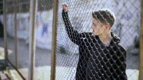 Free Boarding School Restrictions, Teen Boy Behind Fence Confinement, Broken Future Stock Images - 137530494