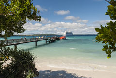 Boarding the Tender Boat back to the Cruise Ship - Lifou. Tourists boarding the tender boat to go back to the cruise ship on Lifou Stock Photography