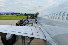 Boarding. Tourists are boarding a Geman Wings plane Royalty Free Stock Photography